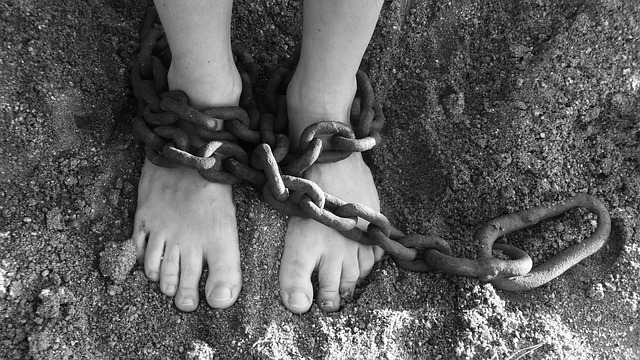 Feet wrapping in chains