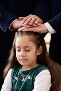 Little girl being blessed