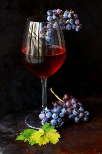 Wine glass with grapes. Photo by Roberta Sorge on Unsplash.com
