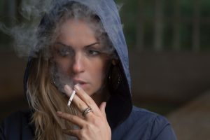 Woman smoking via Stas Svechnikov on Unsplash
